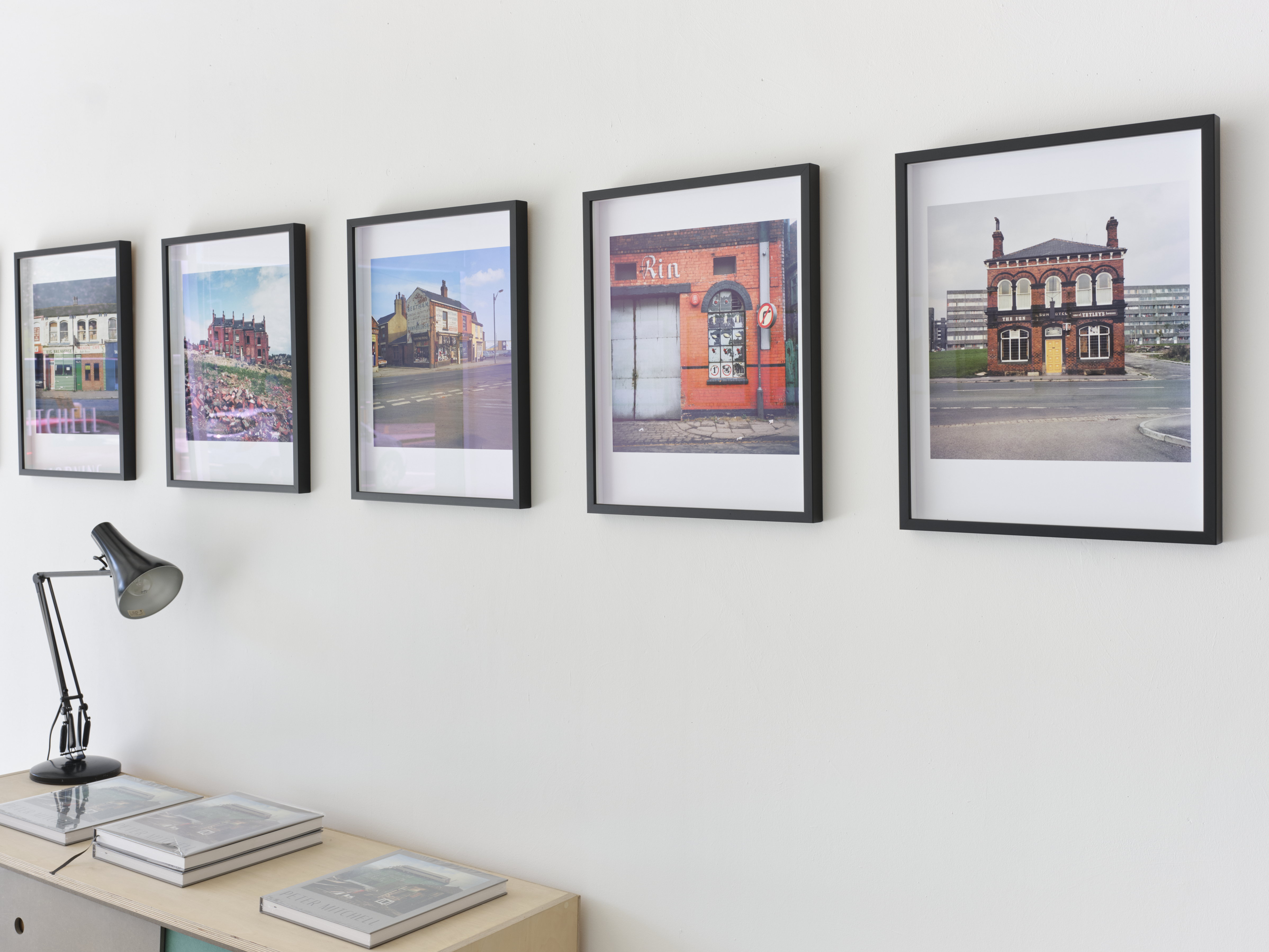 Framed Peter Mitchell photographs hanging on the wall of a gallery