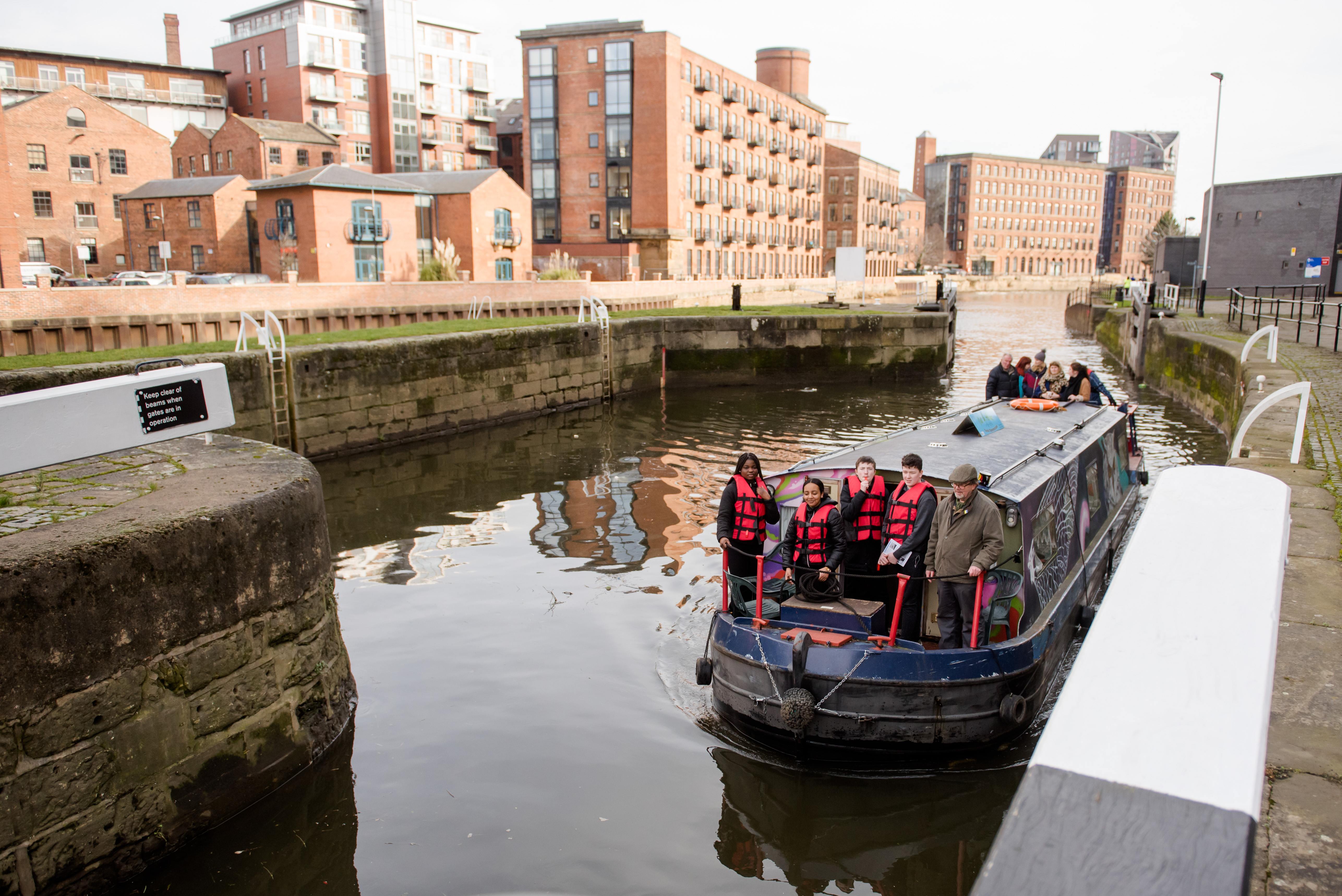 a group on a canal barge