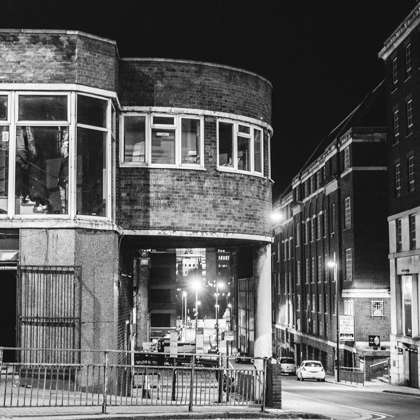 black and white image of the old red bus station