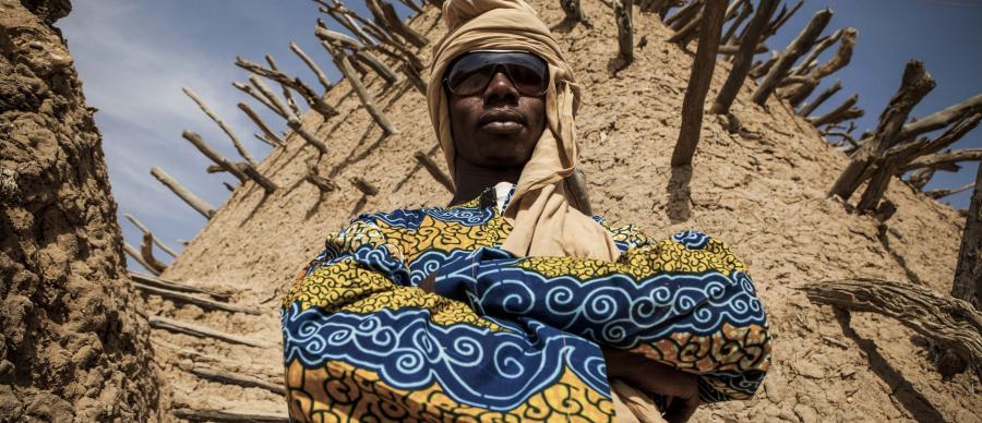 Story of Sahel Sound Film Still - Image of Afro-futurism artists standing with their arms folded.