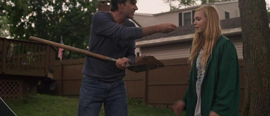 Man holding shovel looks angrily at a teenaged girl