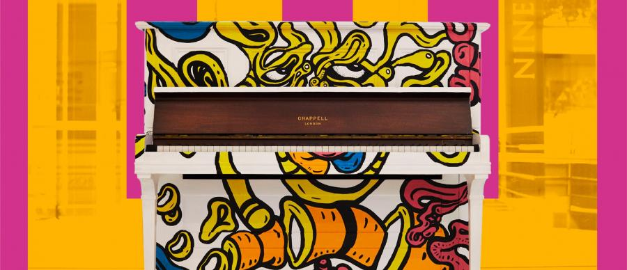 a decorated stand up piano