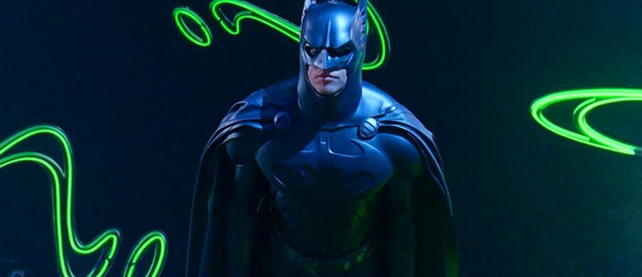 Batman Stands Behind Neon Riddler Logos
