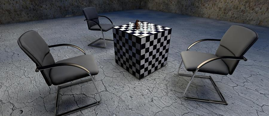 Three empty chairs facing a 3D chess board