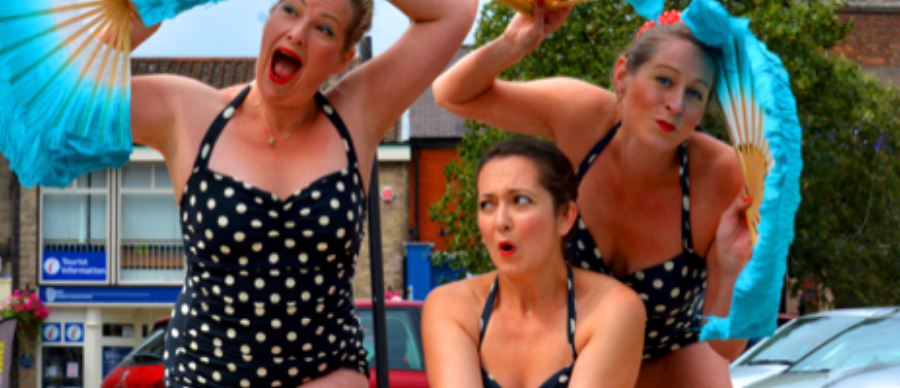 3 female performers in polka dot swimming costumes
