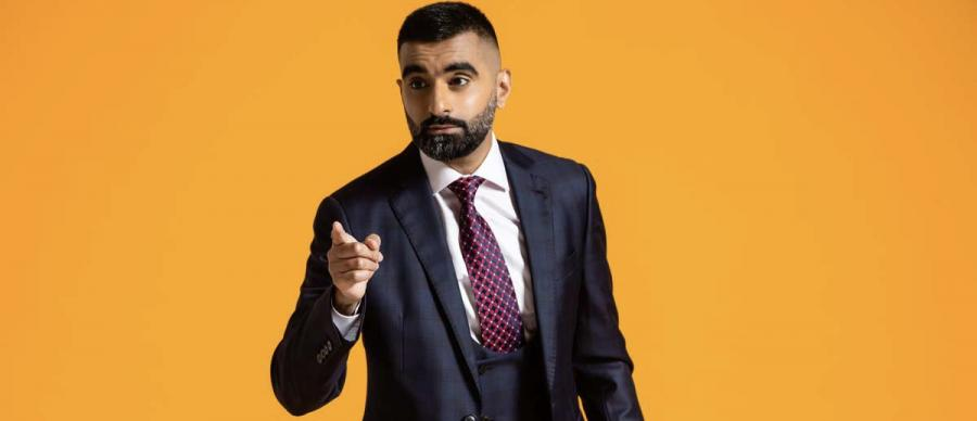 Tez Ilyas pointing at the camera