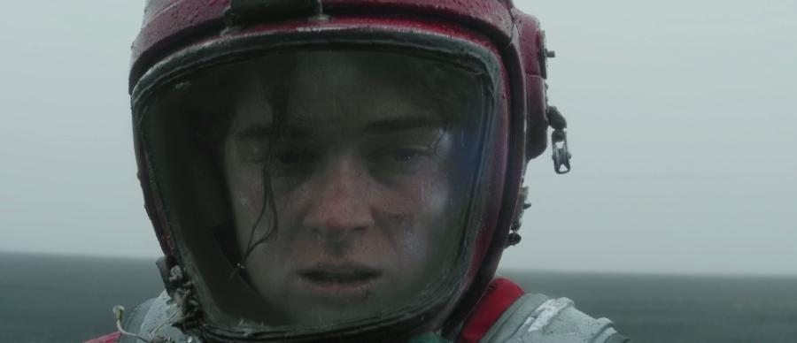 picture shows a man in a helmet looking into the distance