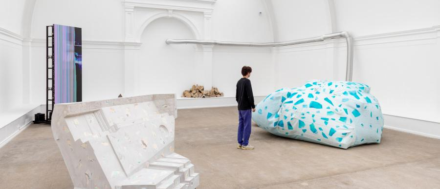 Artist James Thompson looks on at his sculptures in the exhibition Spatial Drifts