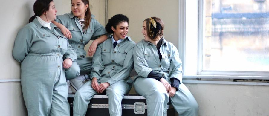 Four women in boiler suits representing the different characters in the Radio Play