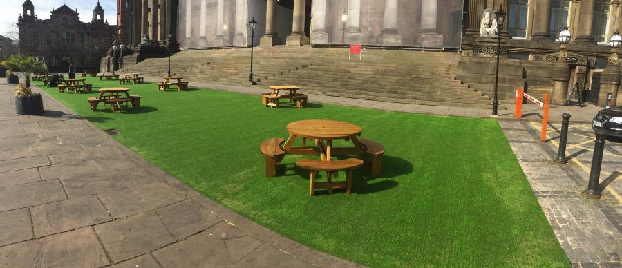 Artificial grass with benches