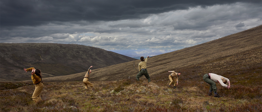 5 dancers move in the open Scottish highlands