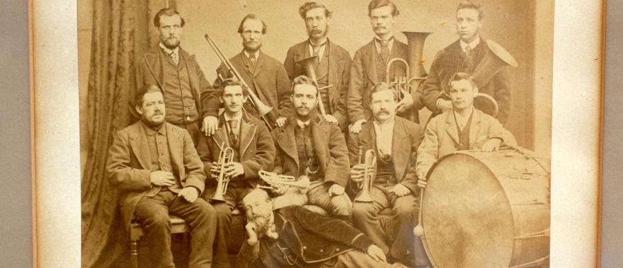 a sepia photograph of a brass band from early 20th Century