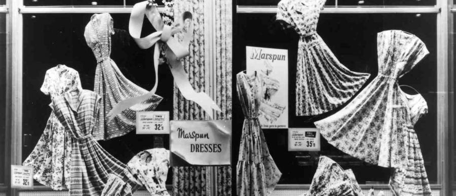 Black & white photo shows a window display of 'Marspun' dresses from the 1950s