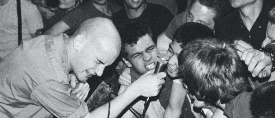 Punk the Capital Film Still. Archive footage of Ian Mackaye performing in the band Fugazi.