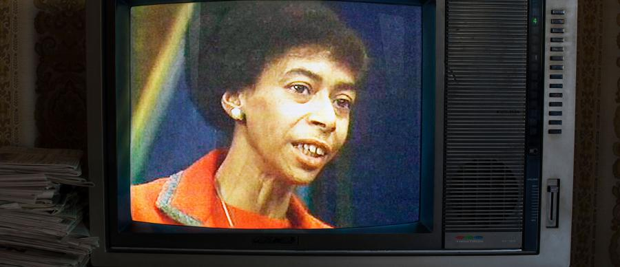 A woman on a television screen