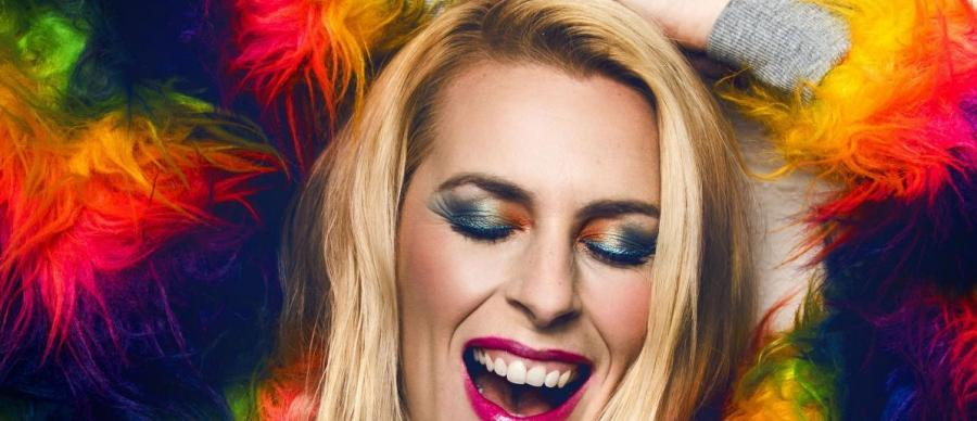 Sara Pascoe in a colourful top smiling