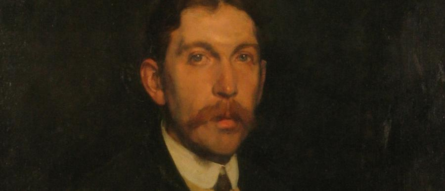 Portrait of a critic circa 1907 by Sir Gerald Festus. A man in with a long moustache and brown hair.