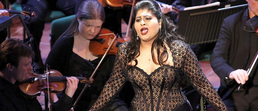 A woman with long black hair singing