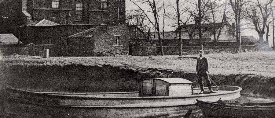 Mill manager William Horn on a boat in the mill pond, taken around 1900