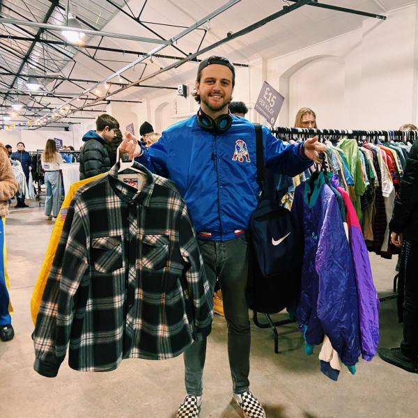 Shop Kilo customer holding their vintage purchases