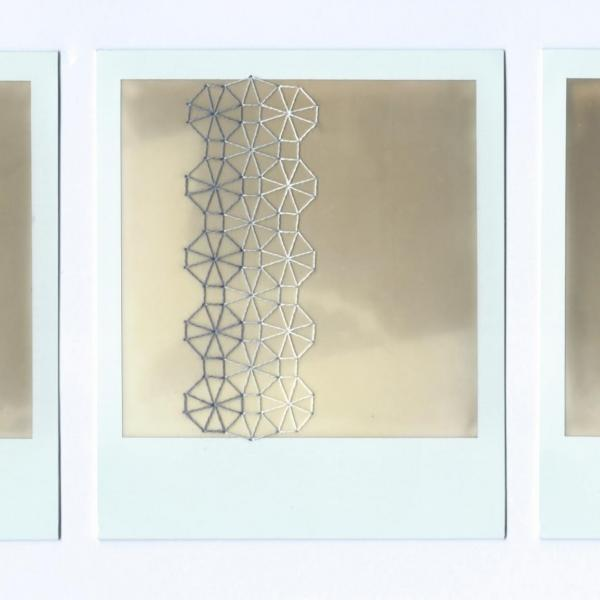 A series of three embroidered Polaroid photographs.