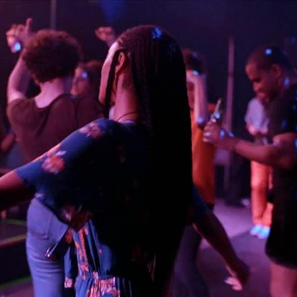Young people dancing in a nightclub