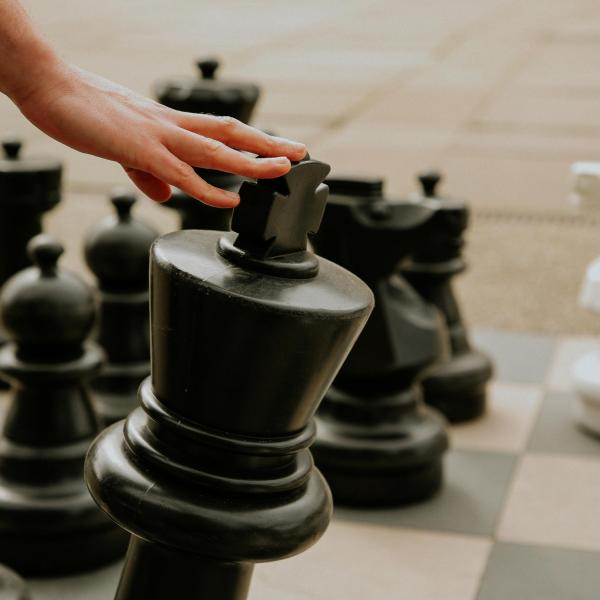 Chess pieces on a giant outdoor chessboard