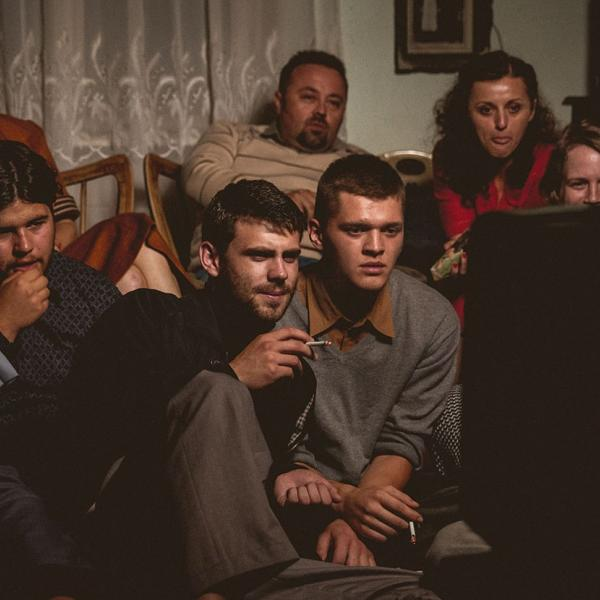 a group of people watching television
