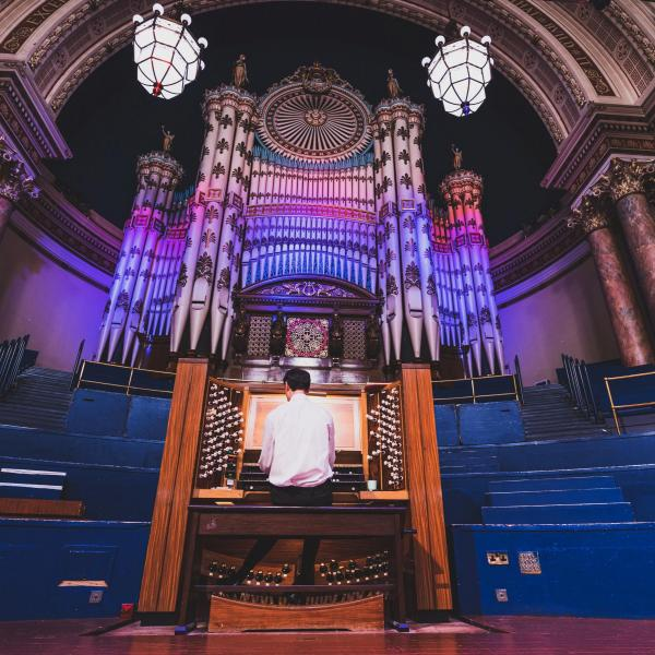Darius Battiwalla with the Town Hall organ