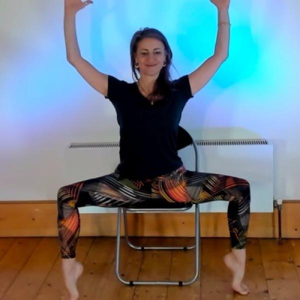 Yoga instructor practicing on a chair
