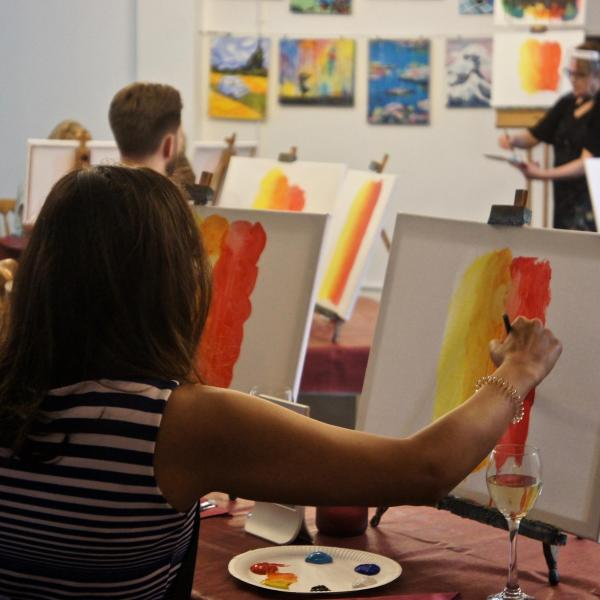 People painting at a popup painting event