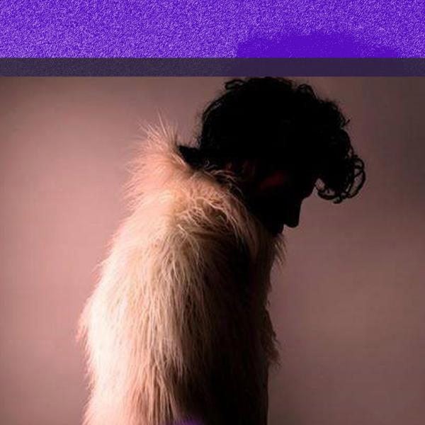 the profile of a person in a fur coat with quiff