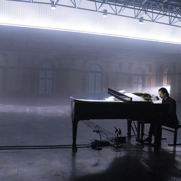 Nick Cave at a grand piano