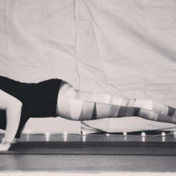 Yoga instructor in chaturanga dandasana