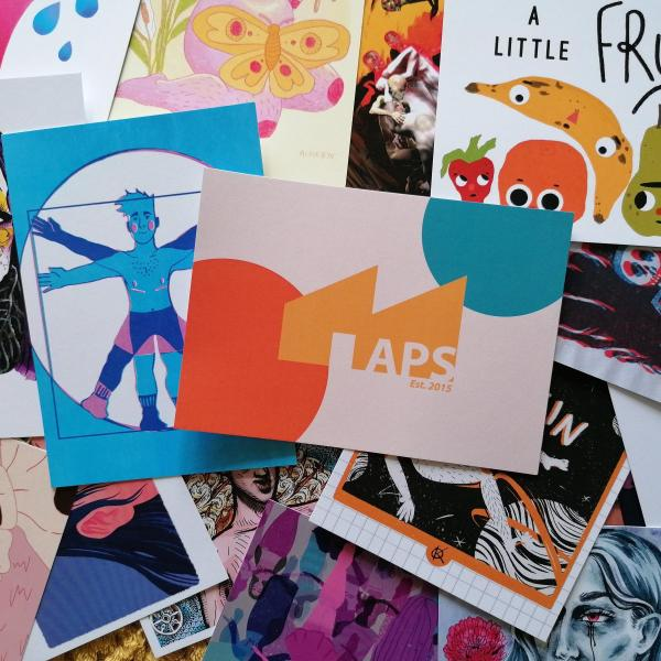 A selection of postcards featuring art from the exhibition
