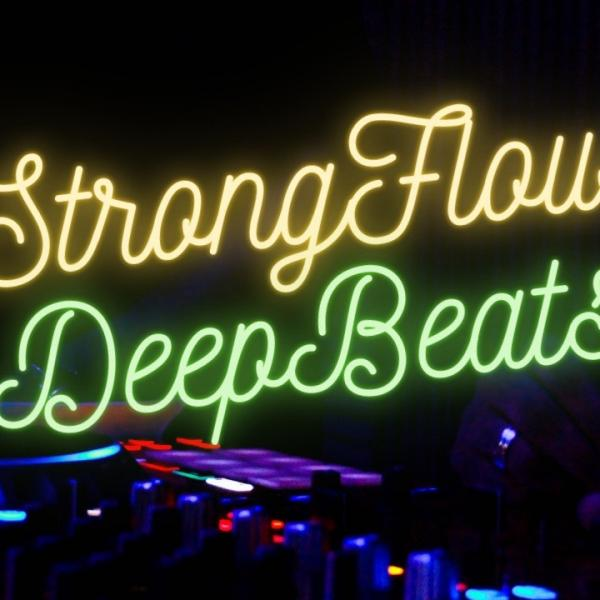 DJ decks and neon text