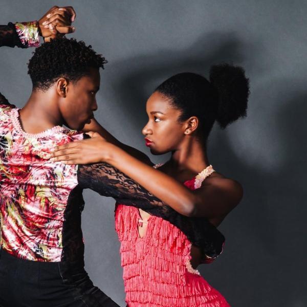 Two people doing Latin dancing.