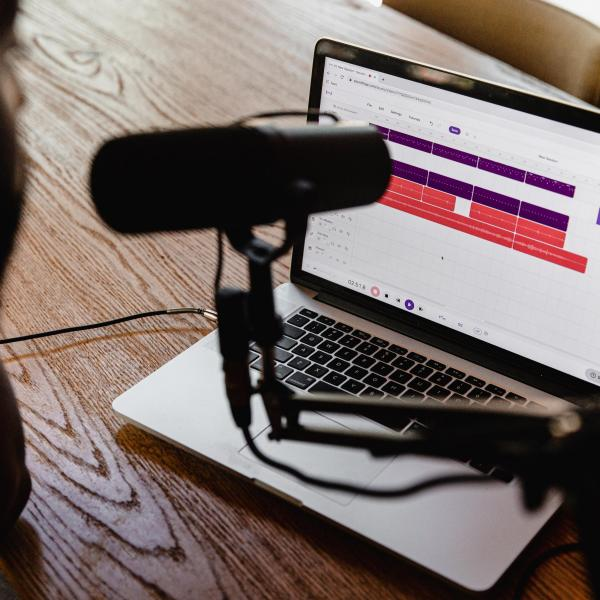 Podcast recording taking place on laptop