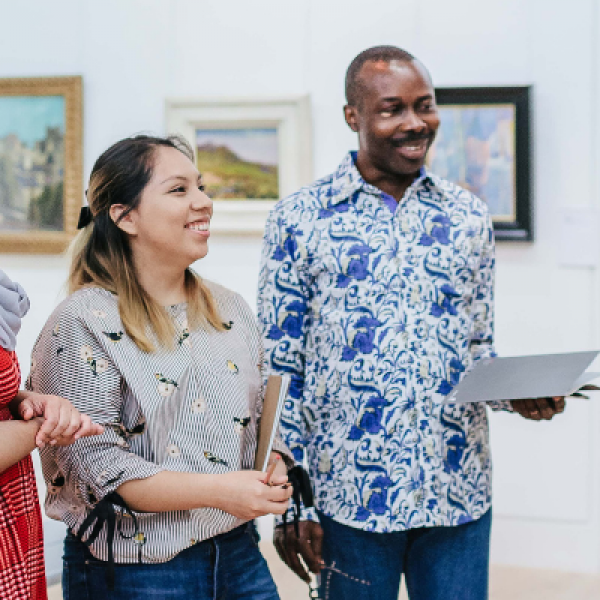 Visitors looking at artwork in the Gallery