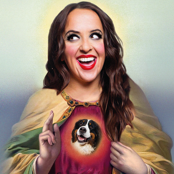 Comedian Luisa Omielan dressed as a saint with a bernese dog on her chest