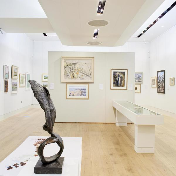 The exhibition space in The Stanley & Audrey Burton Gallery, with a bronze sculpture and paintings