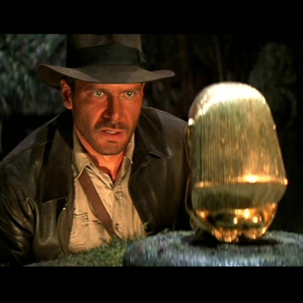 The character of Indiana Jones gazing at a golden object