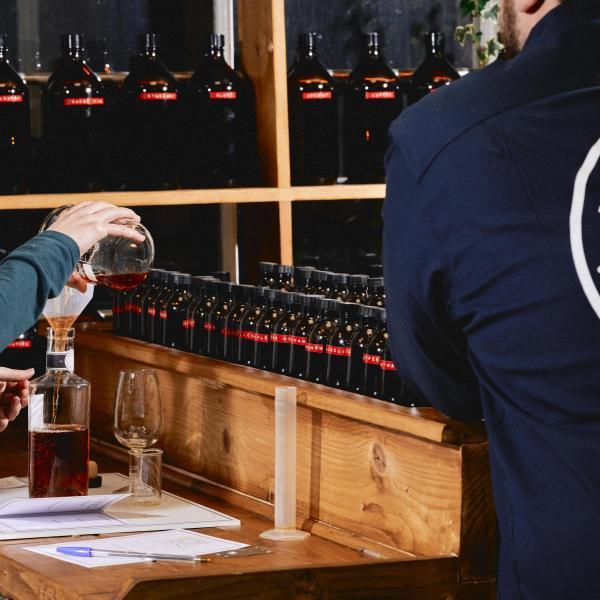 A lady blending a bottle of Spiced Rum in the Blending Room of Liquor Studio