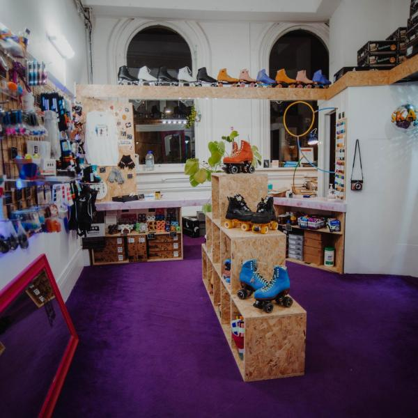 Photograph shows the inside of the Corn Exchange RGG shop, with brightly coloured skates.