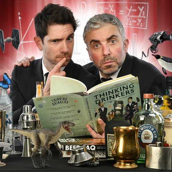 Thinking Drinker duo surrounded with drink shakers and different glasses
