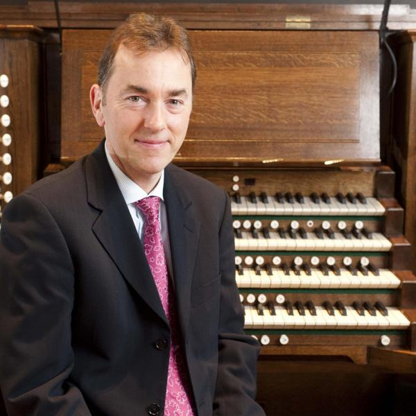 Dr Thomas Trotter with an organ