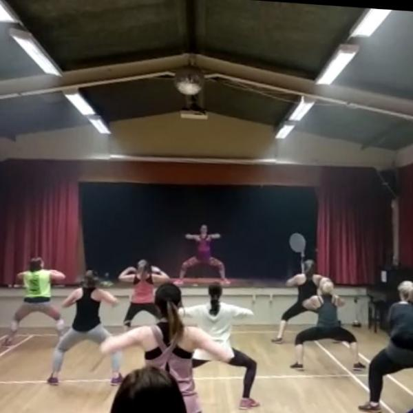 A picture of the participants taking part in a Zumba class with Claire.
